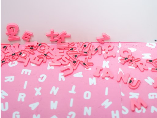 pink and white alphabet magnets